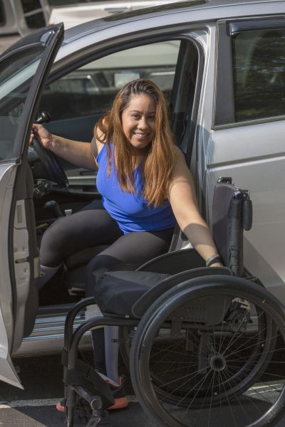 Photo of woman in wheelchair outside